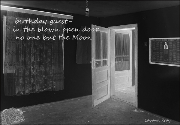 'birthday guest�  / in the blown open door / no one but the moon' by Lavana Kray