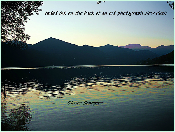 'faded ink on the back of an old photograph slow dusk' by Olivier Schopfer