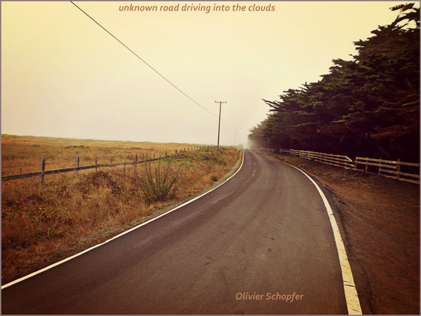 'unknown road driving into the clouds' by Olivier Schopfer