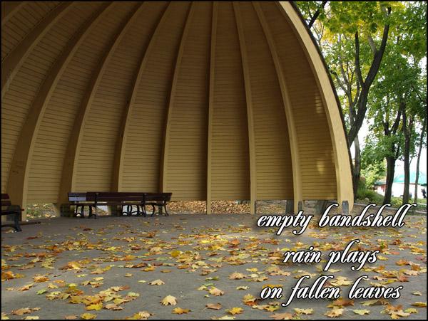 'empty bandshell / rain plays / on fallen leaves' by Jacek Margolak
