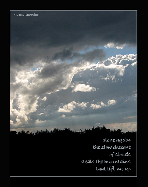 'alone again / the slow descent / of clouds / steals the mountains / that lift me up' by Susan Constable
