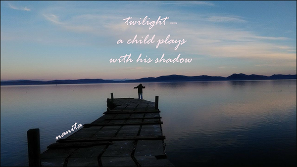 'twilight— / a child plays / with his shadow' by Valentina Meloni