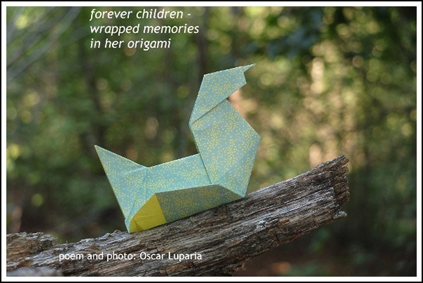 'forever children— / wrapped memories / in her origami' by Oscar Luparia